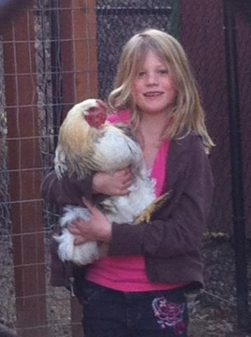 A student with a chicken